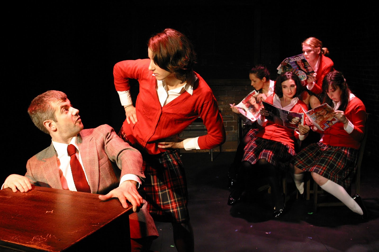 Nick Afka as Desk & Lucy Gillespie as Hazel. Background from back left moving clockwise- Louiza Collins as Anna, Lillian Meredith as Jenny, Laura Wiese as Dina, and Sarah Ann Masse as Chelsea