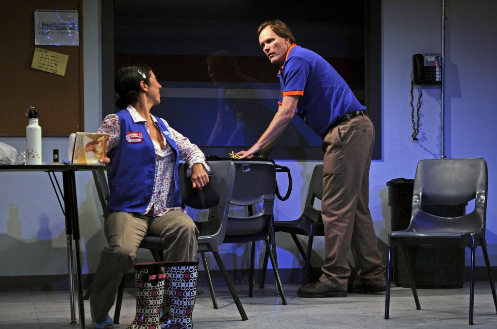 Anna (Sarah Nina Hayon) and Will (Andrew Garman) share the breakroom after hours (Photo Credit: Stephen Taylor)